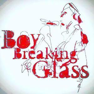 Boy Breaking Glass